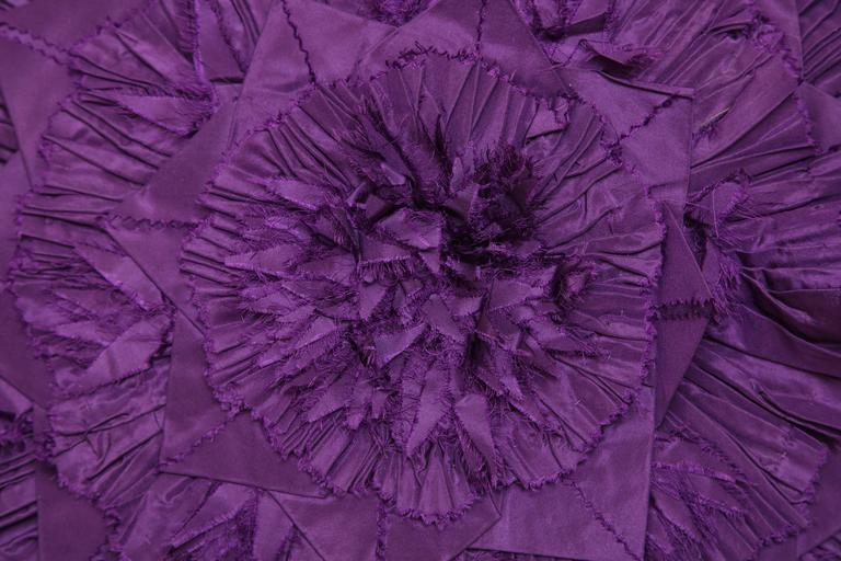 This large purple pillow is one of a kind. The distressed floral design speaks true to Lili Piazza's style. The bright purple color is a continuation of her ongoing mission to design unique and chic decor. This custom-made pillow is designed by Lili