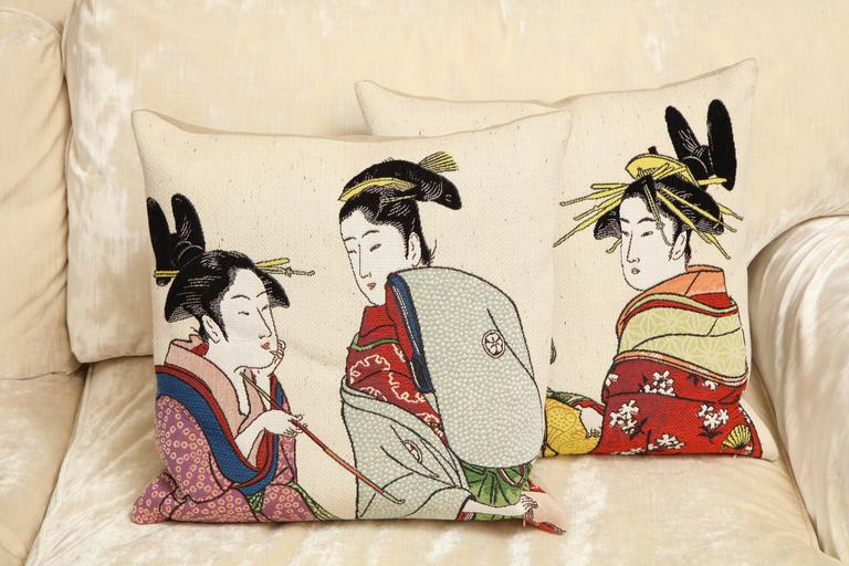 These cotton tapestry pillows are one of a kind. The woven tapestry style is associated with ancient Japanese style art. It's multicolored pallet highlights decorative flower patterns on the kimonos. This pair of custom made pillows are designed by