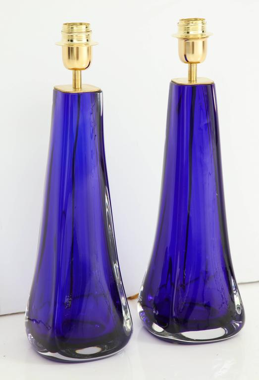 "Pair of stunning Murano cobalt blue handblown glass lamps. These lamps have been made in the ""Sommerso"" technique. The height to the top of the glass is 14.75"". Sommerso (lit. ""submerged"" in Italian), or ""sunken glasses"", is a"