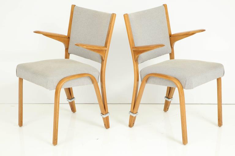 Rare pair of French 1950s Hugues Steiner armchairs, each having paddle form arms and upholstered backs and seats.