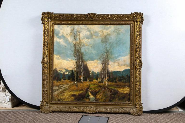 A fine antique painting depicting the beauty of natural pastures with lifelike trees with big blue sky up above; charming cottages complete the landscape. A great 19th century painting in its original gilt wood frame.