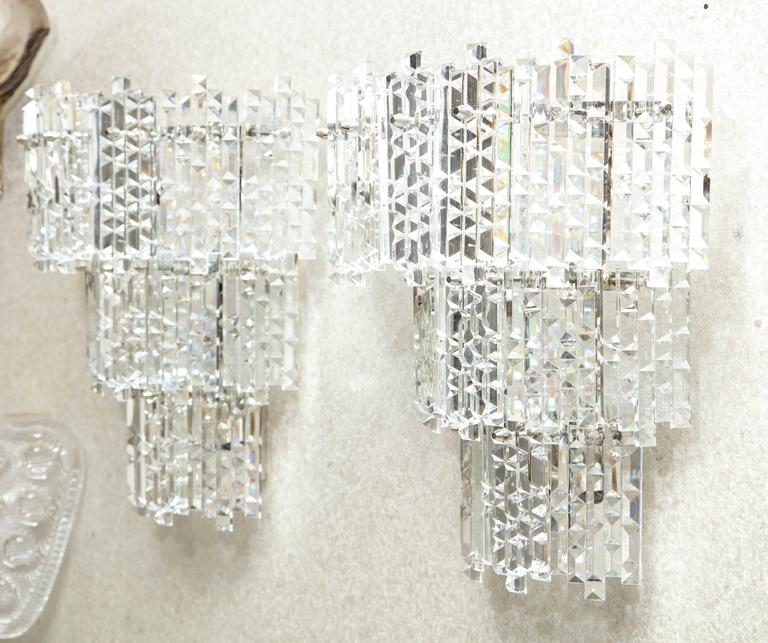 Pair of impressive three-tier Austrian crystal sconces with rectangular prisms featuring geometric facets. rewired for use in the USA using candelabra type bulbs. Made in the 1970s with a strong Art Deco influence.