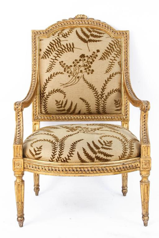 Pair of very fine 18th century Italian carved giltwood armchairs with shell motif. The chairs are upholstered in a botanical themed woven linen fabric. The price listed is for one pair but there is another pair available for purchase.