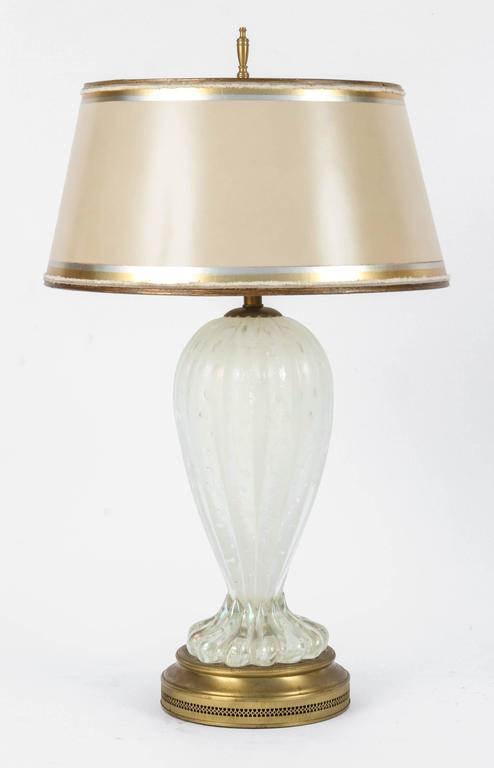 Pair of Mid-Century Italian Murano iridescent lamps with white controlled bubbles on original bases that have been recently gold leafed.  The shades are included and are handmade of parchment paper. They are hand gilded and decorated in coordinating
