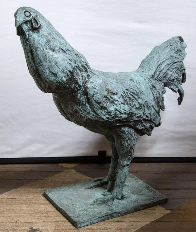 This rooster, signed by the artist has a green/blue patina. Signed on the base Carl Pappe, Taxco, Mexico Carl Pappe, 1900-1998.