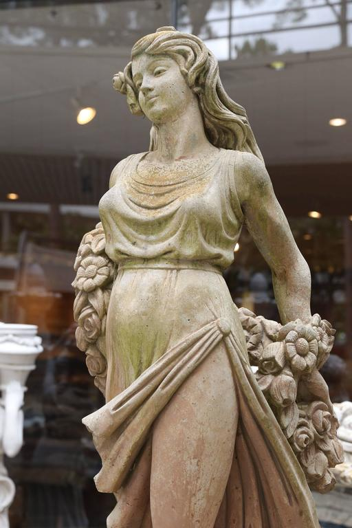 Garden Statue Of A Beautiful Woman In A Cast Material At