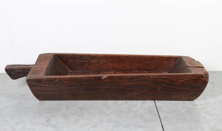 A rustic and distinctively shaped antique tray carved from a single piece of wood. This heavy piece works perfectly as a centerpiece or filled with fruit or flowers. From China, Yunnan Province, circa 1900. TR152a. a b h a y a