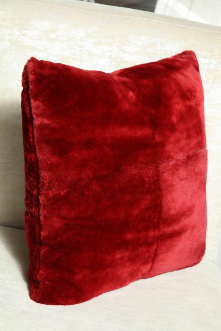 Red genuine sheared beaver pillow.