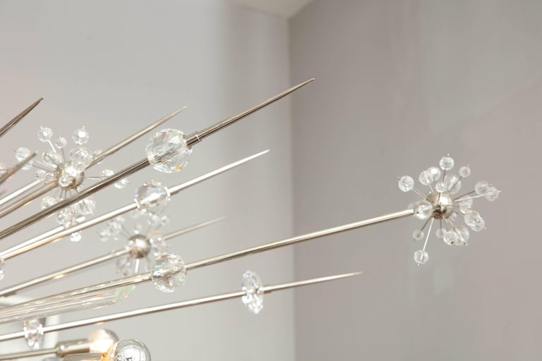 Monumental Austrian crystal and glass rod Sputnik in polished nickel.