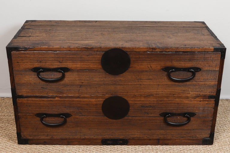 Kiri wood with original handcrafted hardware. Both pieces same height for use as side tables.