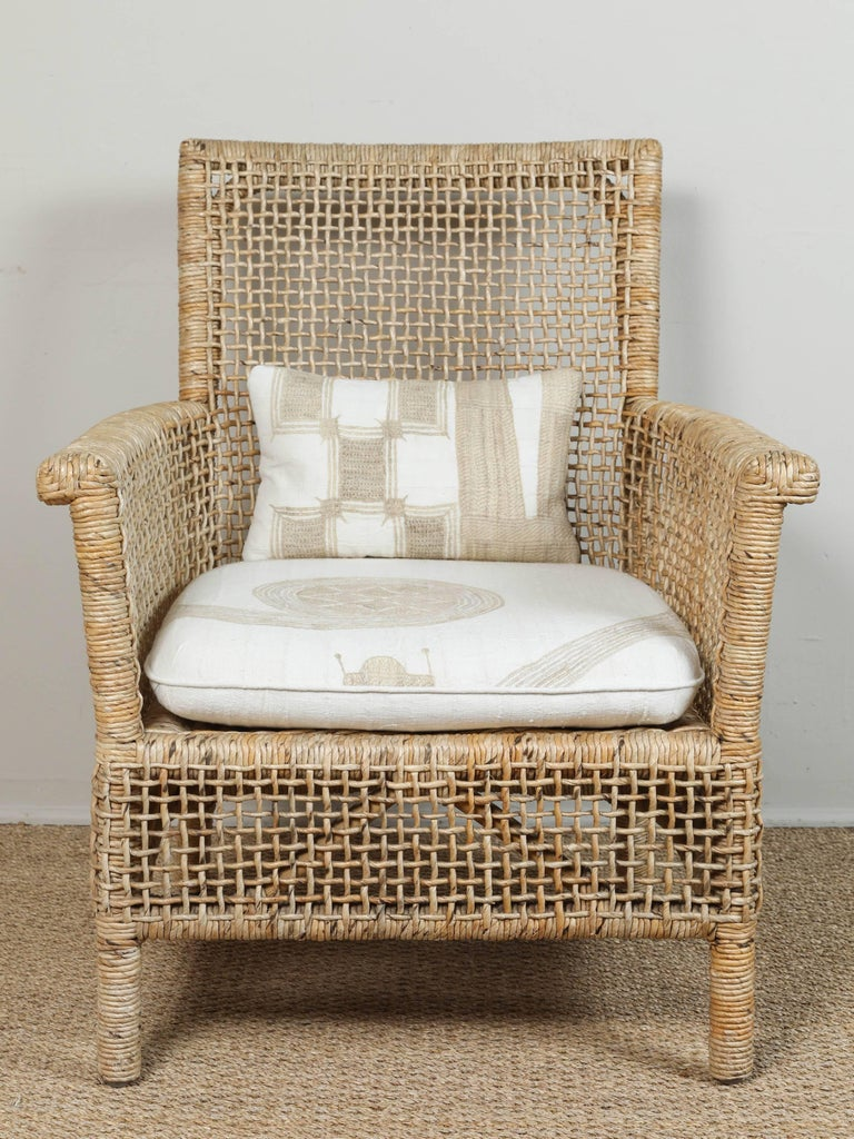 American Rattan Chair and Ottoman with African Textile Cushions For Sale