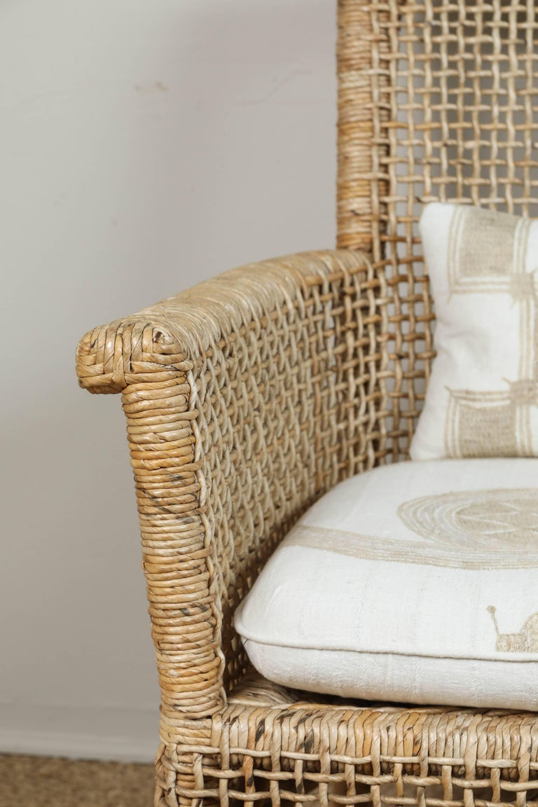 Woven Rattan Chair and Ottoman with African Textile Cushions For Sale