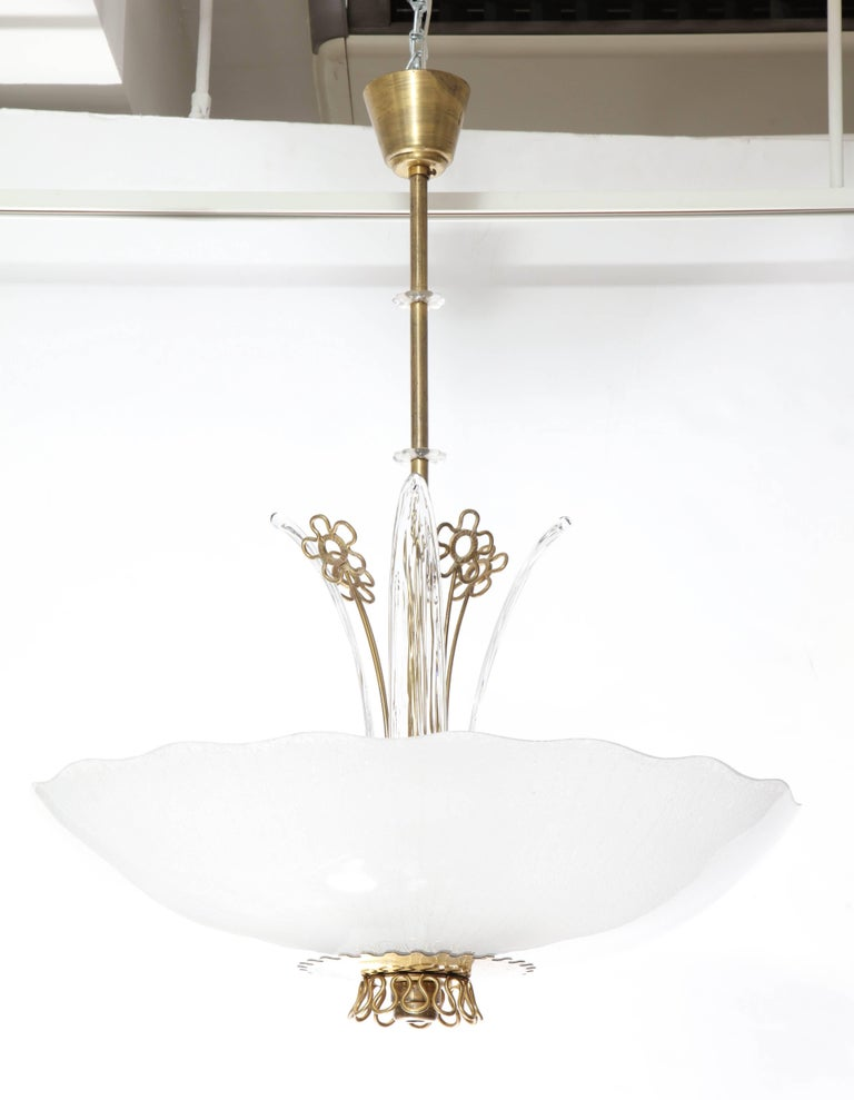 A pair of Orrefors chandeliers with brass frame with lily -shapes. Large bowl-shaped frosted glass shade, eight sockets and four glass