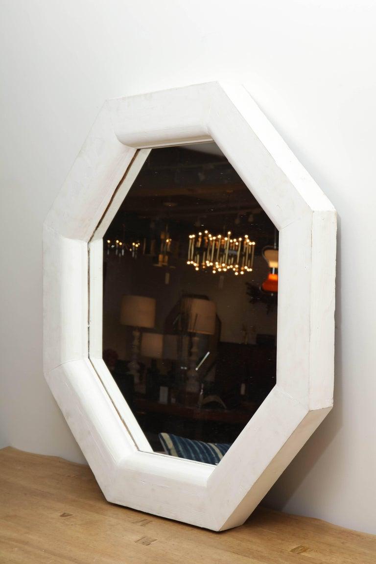 Vintage white octagonal mirror.