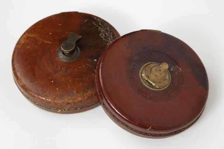 Vintage leather and brass tape measure. Measures: 66 ft.