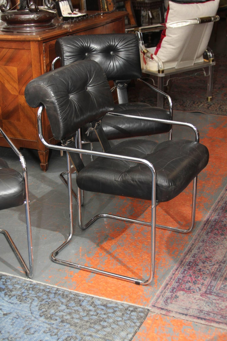 Mariani for the Pace Collection set of four chairs in black leather with leather lacing front and back. Chromed frame, very comfortable chairs. Great as side chairs or at a dining table.