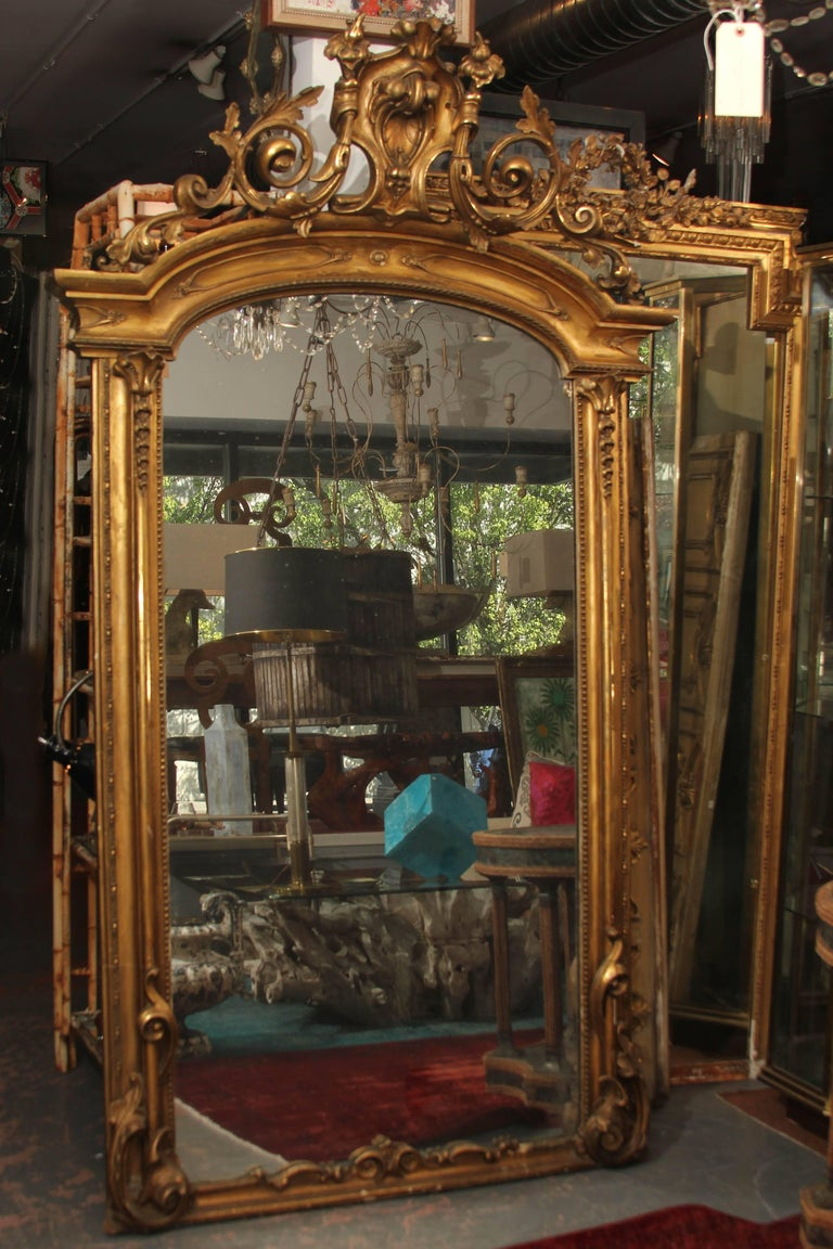 Beautiful ornate antique floor mirror with original glass. Great color and patina to the frame and lots of sparkling diamond dust in the mirror when the light hits it just right.