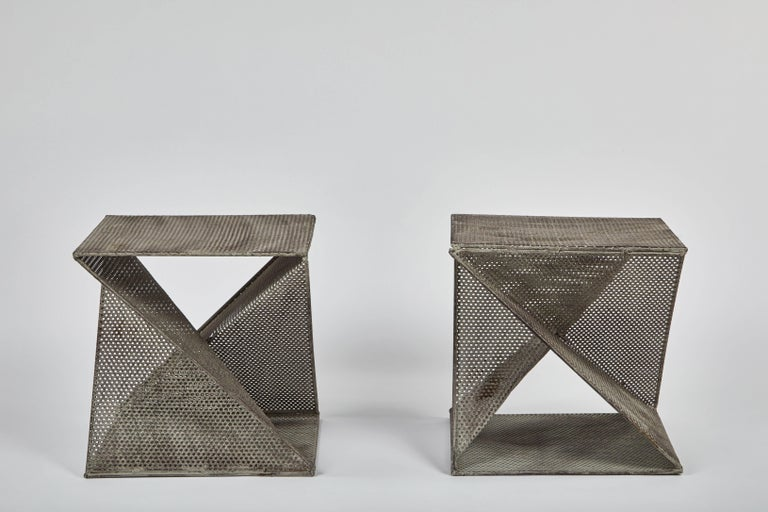 Pair of geometric perforated metal side tables in the style of Mathieu Matégot, in original condition.