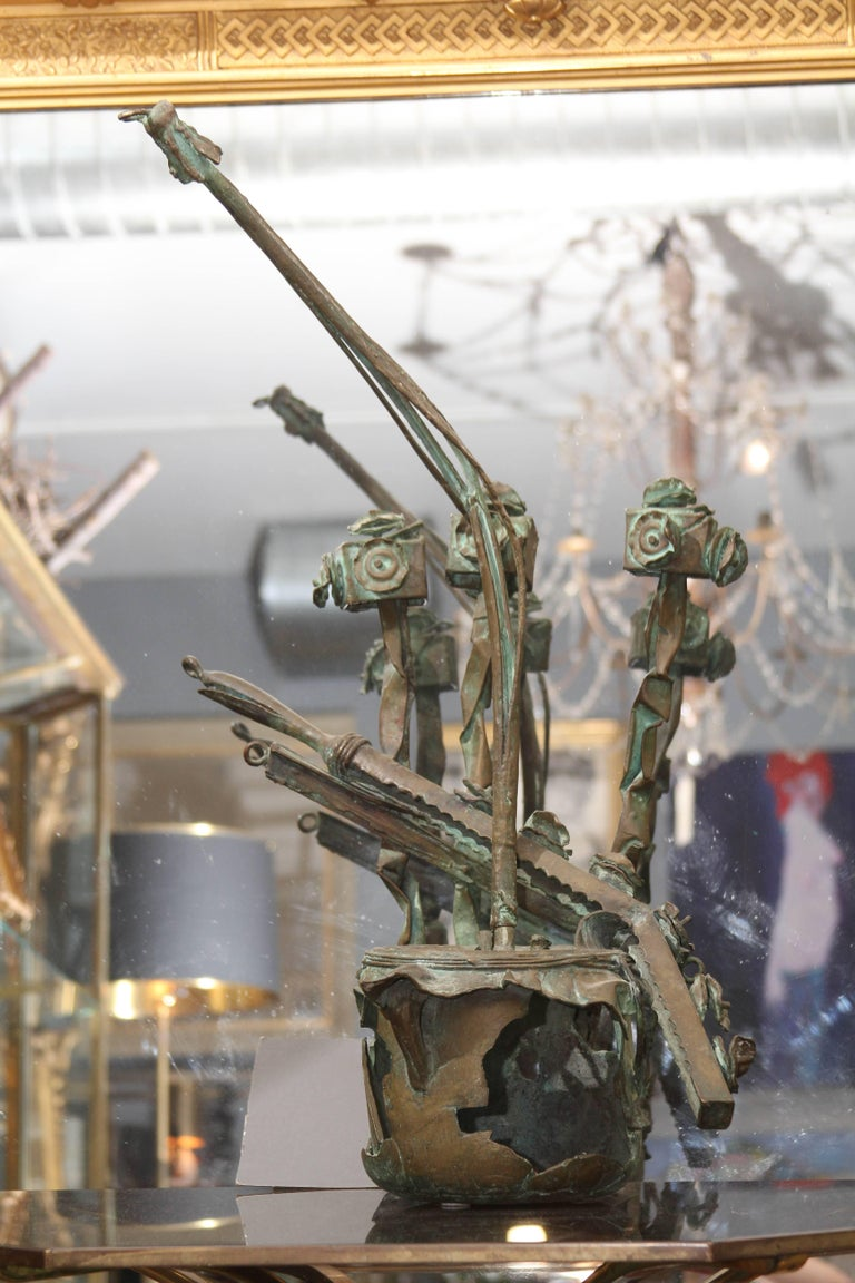Mid-Century bronze sculpture of a group of musical instruments. Beautiful patina and great composition. Artist signed