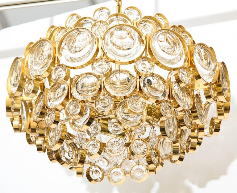 Amazing Austrian optic crystal chandelier on a 22-karat gold over brass frame. The chandelier gives off an amazing glow when illuminated and has been rewired for use in the USA using candelabra type bulbs.