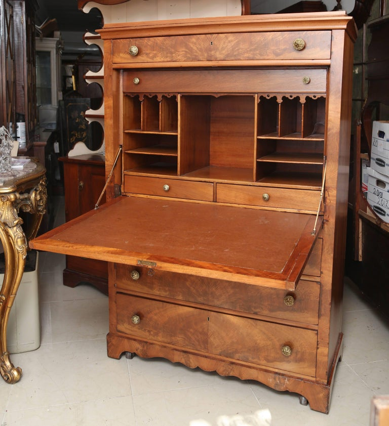 This is a very nice antique walnut escritoire made in France, circa 1890 original brass handles inside the flap it has drawers with again with original price handles pigeon holes and a leather brown surface for writing. Measurements are 42 x 19 x 62.
