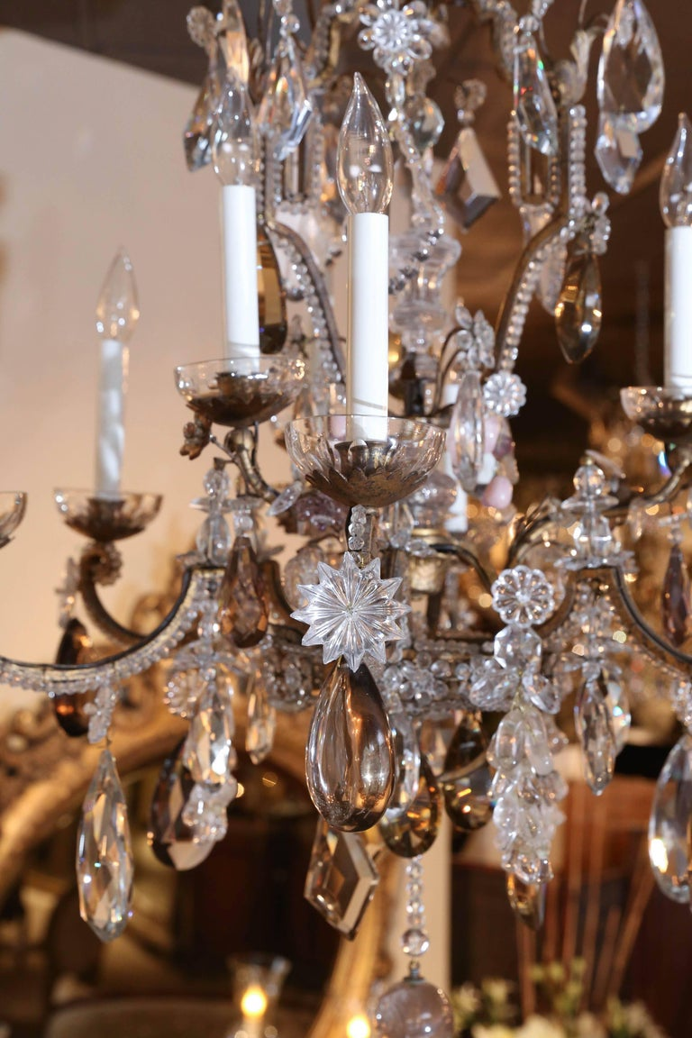 Fine bronze chandelier enhanced with small crystal beads that outline the