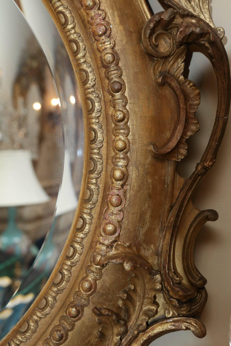 French Pair of Louis Philippe Giltwood Oval Mirrors, 19th Century Rococo Revival Taste For Sale