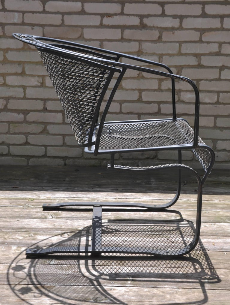 Set of four Mid-Century Woodard hand-formed wrought iron chairs, classic contoured diamond-mesh barrel back with hallmark