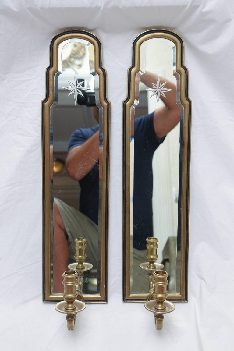 Vintage pair of Chapman mirrored sconces (non electrified) with etched starburst design near top. Solid brass frames.