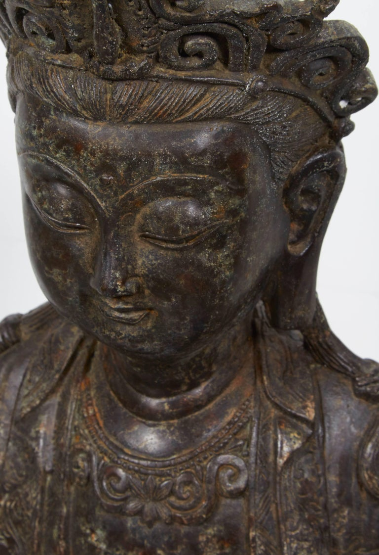 An unusually tranquil antique standing bronze Buddha with a sweet face and a remarkably calming presence.  a b h a y a BH558.