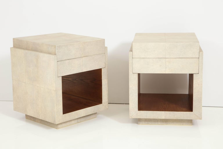Decorative shagreen bedside tables with two drawers. The side tables have the palm wood inside the opening. We will have them in stock.