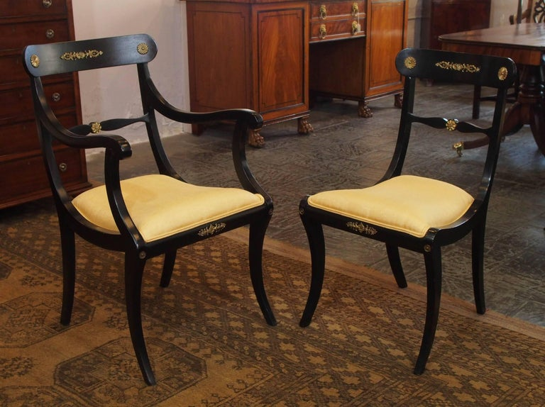 Set of eight ebonized dining chairs, Regency style, circa 1920.