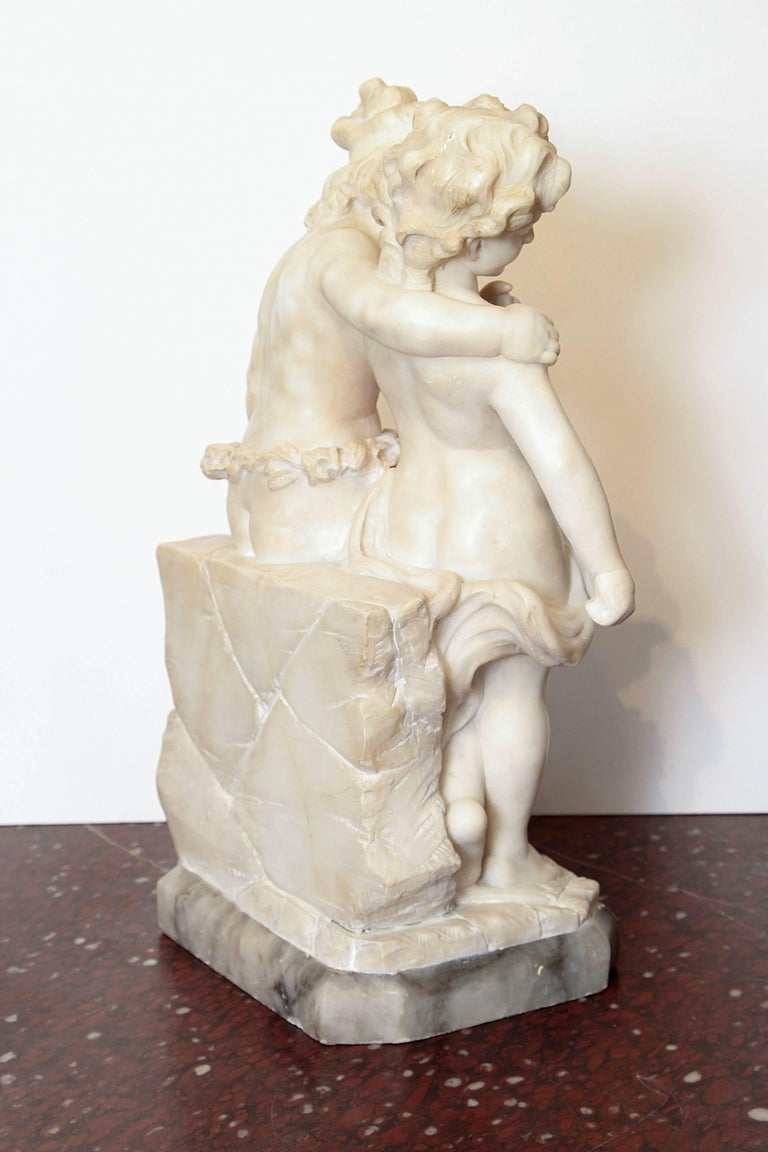 Carrara Marble 19th Century Italian Marble Sculpture of Two Children Sitting on a Wall For Sale