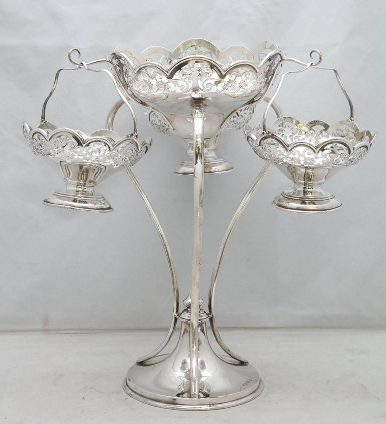 Beautiful, Edwardian-style all sterling silver epergne/centerpiece (made during the reign of King George V) having three hanging, removable sterling silver baskets and one central, stationary bowl, Birmingham, England, 1919, Charles S. Green and Co.