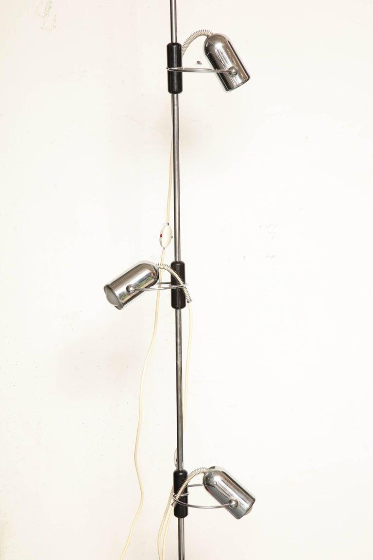 Reggiani articulated floor lamp extends floor to ceiling Mid-Century Modern, Italy, 1970s Height adjusts.