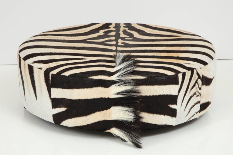 Zebra Hide Ottoman, Offered by Area ID In Excellent Condition For Sale In New York, NY