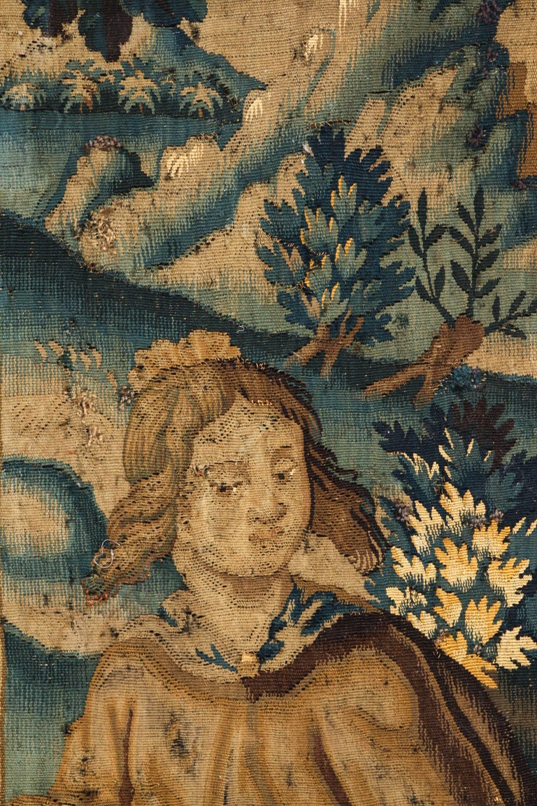 Flemish tapestry fragment, circa 17th-18th century. Contemporary framing without glass. Tapestry mounted on board with grey fabric and grey wood frame. Measure: 34