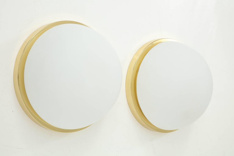 Extra large flush mount or sconces fixtures by Limburg. These fixtures are stunning, chic and timeless and will fit into any interior. The large frosted glass dome fits into a polished brass mounting plate which creates a warm light when
