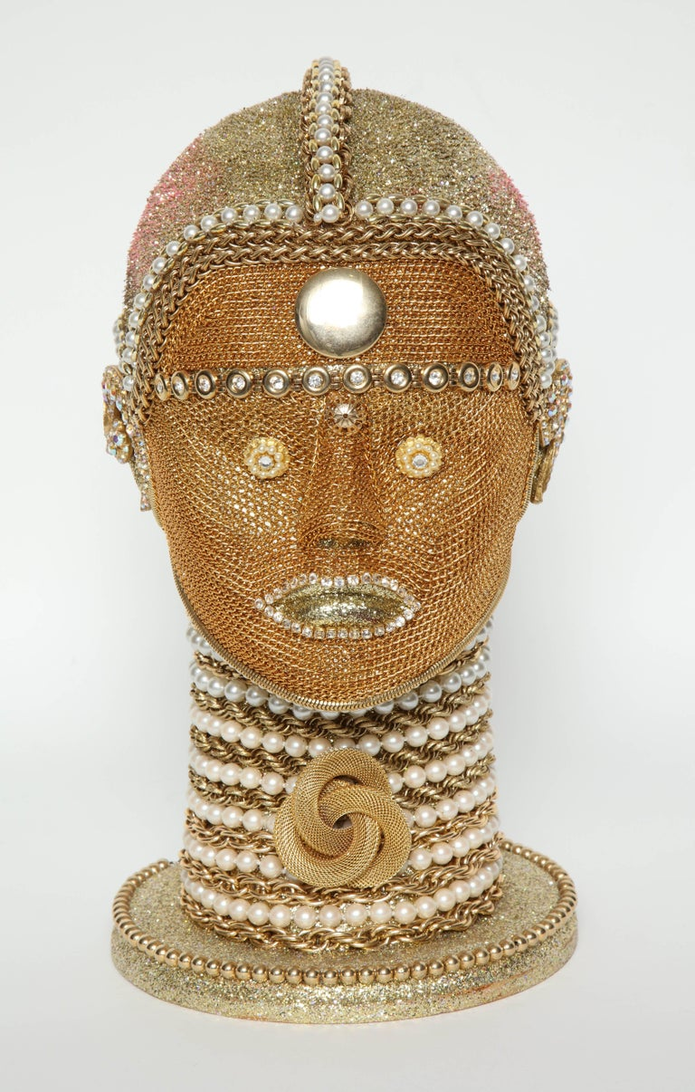 Stunning futuristic android bust by W. Beaupre. Bust is embellished with intricate gold chain, pearls and vintage jewelry findings. The attention to detail and craftsmanship is quite remarkable.