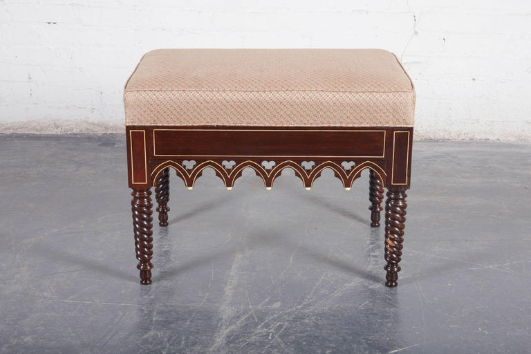 Each with rectangular upholstered seat over a Gothic-arched and trefoil apron, raised on spiral-turned legs terminating in toupee feet.