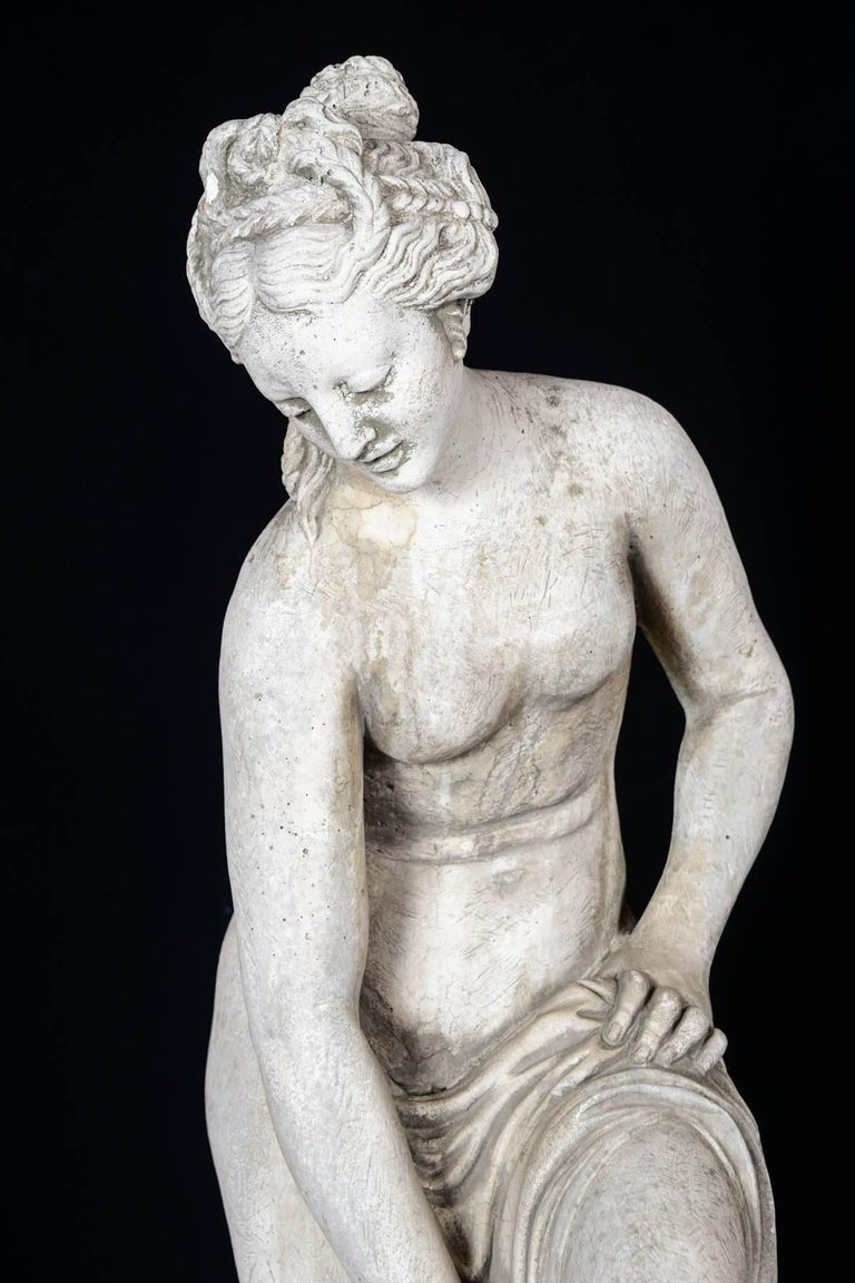Sculpture in concrete of a bather exiting her bath, 20th century.