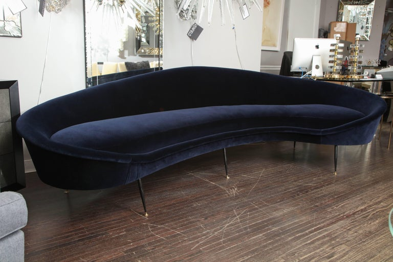 Custom curved sofa with brass legs. As shown in Navy velvet.