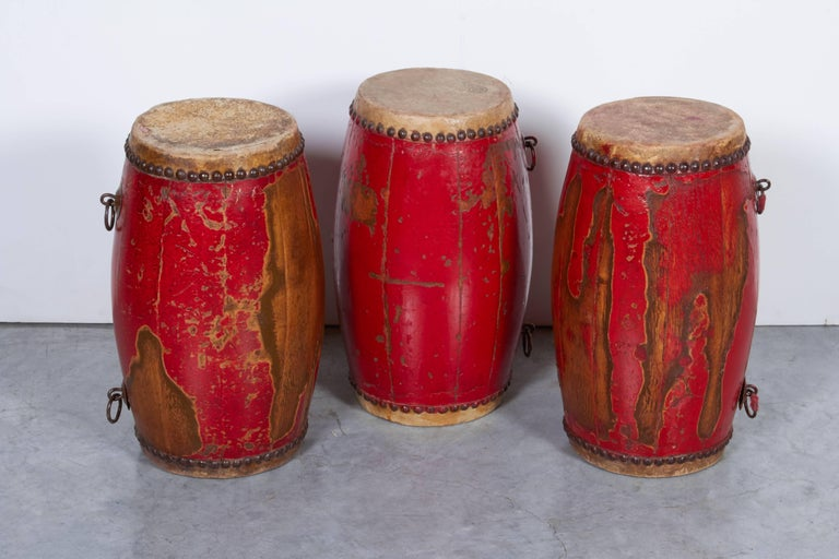 Three antique Chinese Provincial drums displaying great wear from years of use in small Provincial and military bands. Work nicely as group or individually and provide a striking splash of color. From Hebei Province. M900.