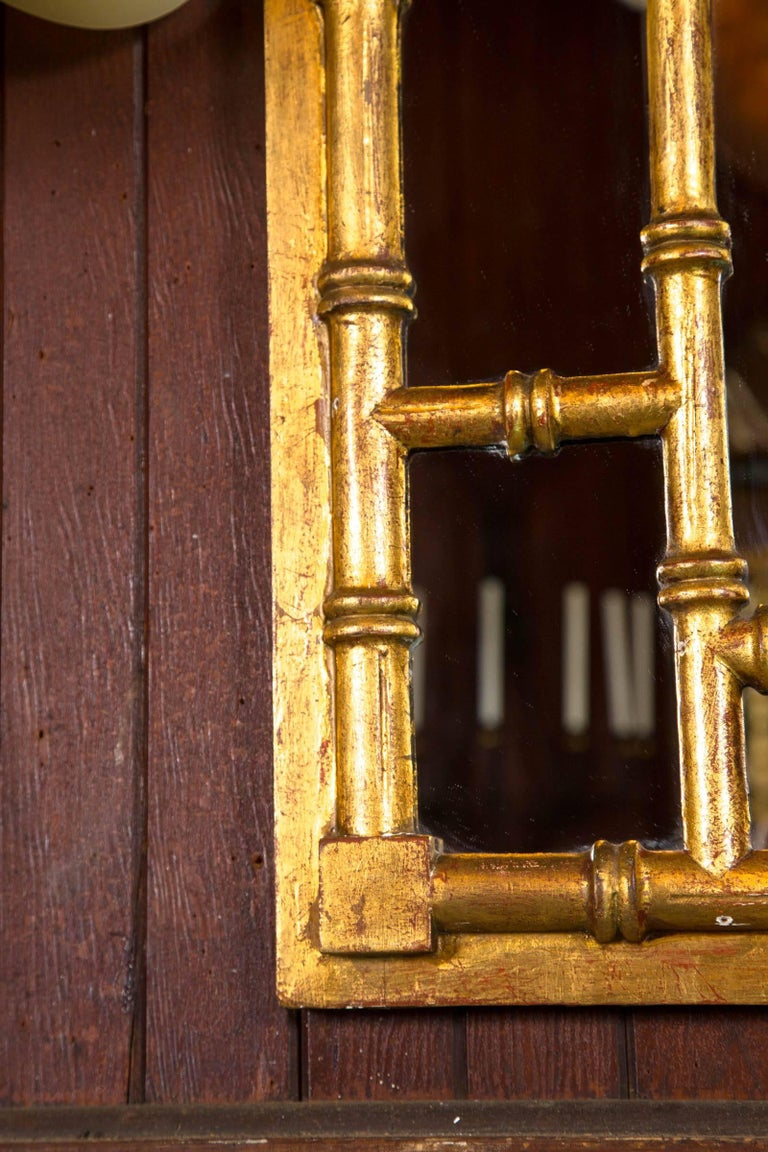Chinese Chippendale style carved wood faux bamboo and gilt mirror with Greek Key design.