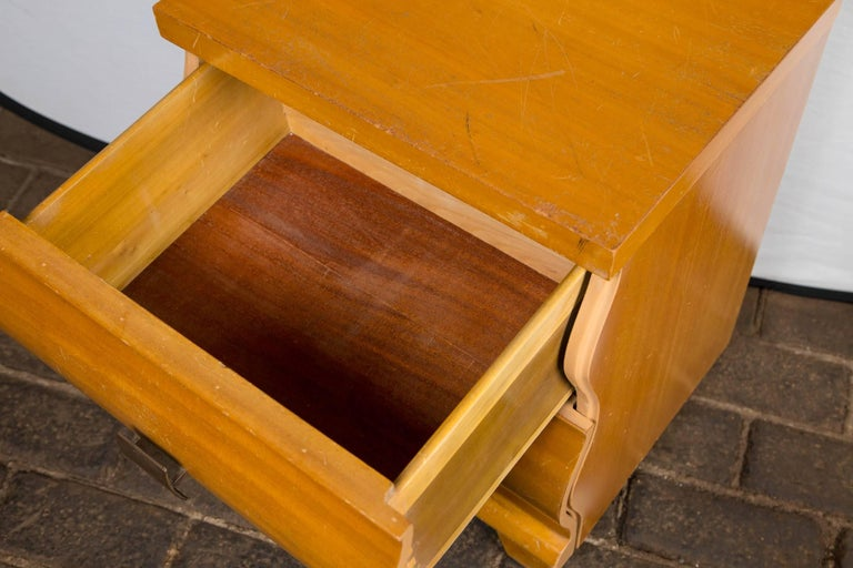 Bedside or end table attributed to Edmond Spence with stylish undulating 