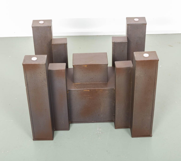 Large steel block in various sizes supporting glass top to create dramatic console table.