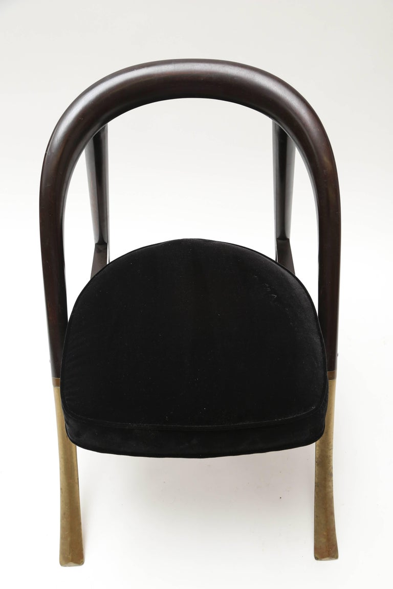 An elegant design from the master of historical modernism manufactured by Dunbar.