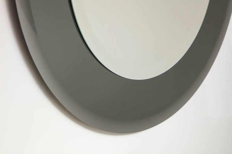 American Grey Glass Round Mirror in the Style of Karl Springer For Sale