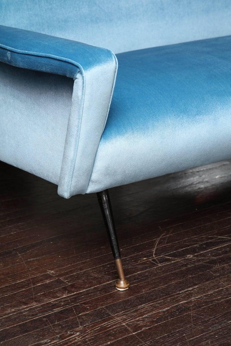 Custom velvet settee with brass legs.