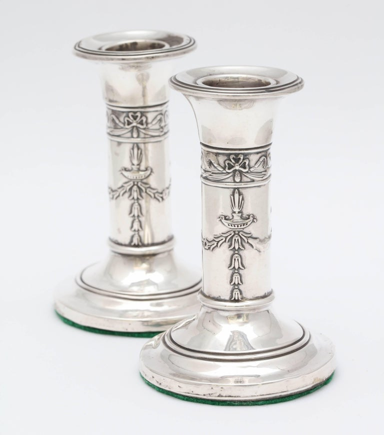 Lovely, small pair of Edwardian, sterling silver candlesticks, Birmingham, England, 1906, Levi and Salaman - makers. Pretty design on columns. 4 inches high x 2 1/2 inches diameter across base of each. Weighted. Both have some minor dints (see